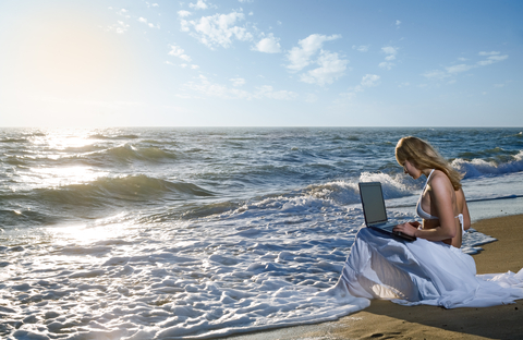 http://www.dreamstime.com/stock-photos-blond-girl-using-laptop-sea-image16885613